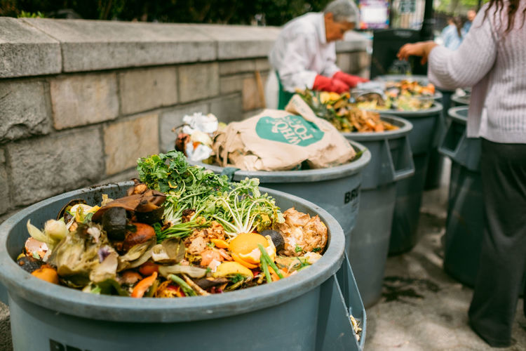 Food And Drink Food Real People Vegetable Standing Incidental People Day Healthy Eating Wellbeing Adult Women People Focus On Foreground Market Midsection Men Variation Preparing Food Preparation  Outdoors Recycling