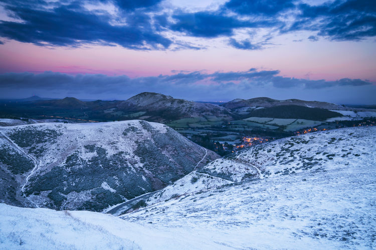 Twilight Sky over Snow Covered Hills City Hills Mountain View Twilight United Kingdom Beauty In Nature Cloud - Sky Cold Temperature Countryside Day Landscape Mountain Mountain Range Nature No People Outdoors Scenics Sky Snow Sunset Tranquil Scene Tranquility Village Weather Winter