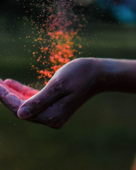 Close-up of person hand holding powder paint