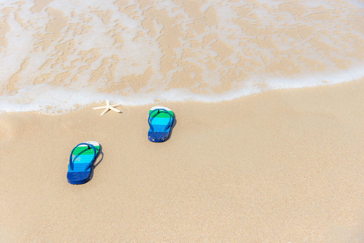 High angle view of toy on beach