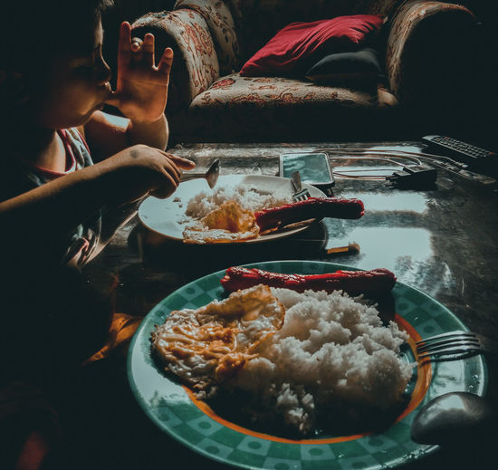 Girl Eating Food At Home