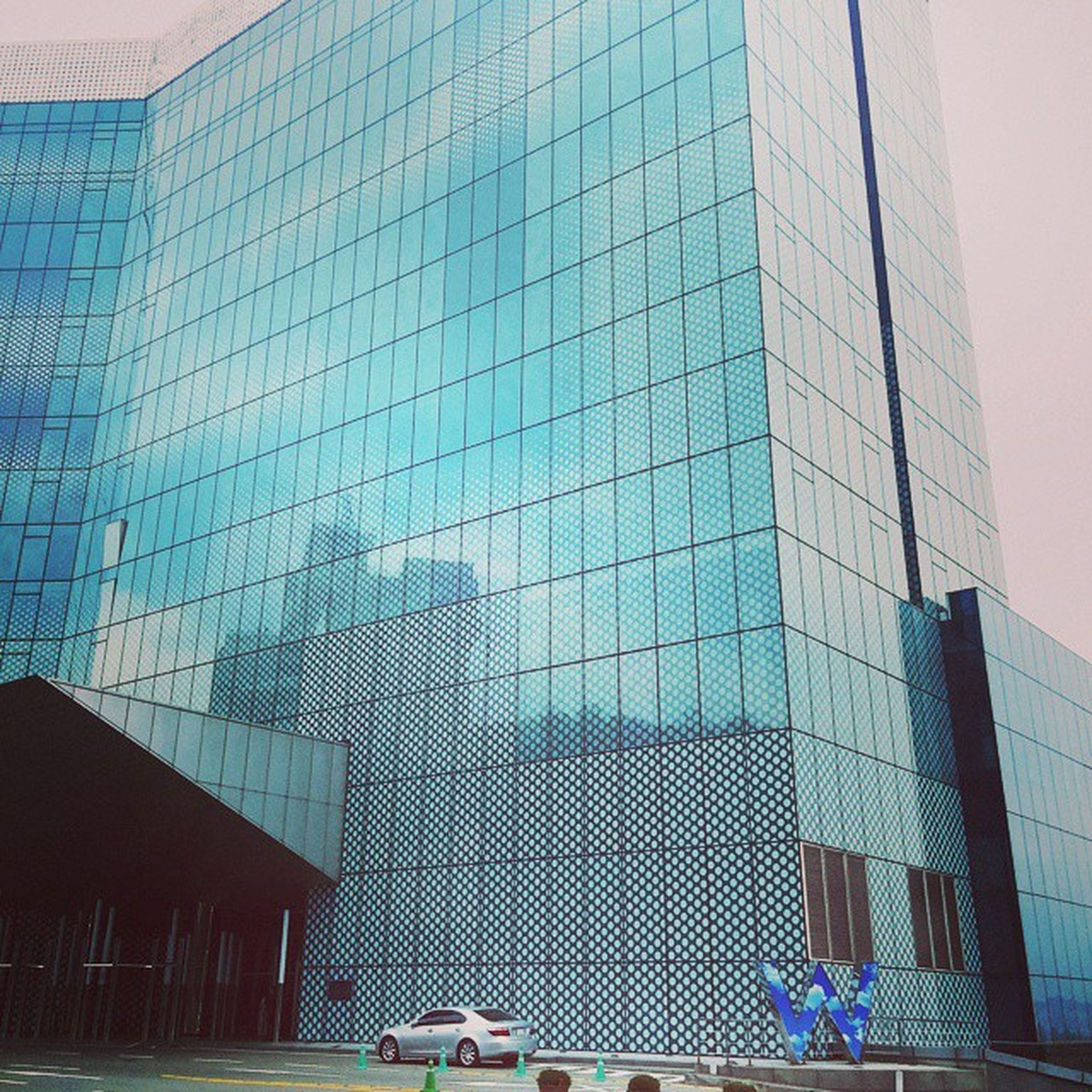 architecture, building exterior, built structure, city, modern, office building, low angle view, glass - material, building, skyscraper, tall - high, sky, tower, window, day, city life, no people, outdoors, reflection, blue