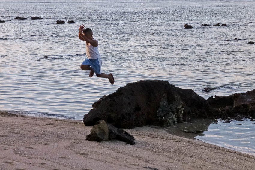 Beach Boy Jumping Mid-air Motion One Person Outdoors Sea Seaside Water