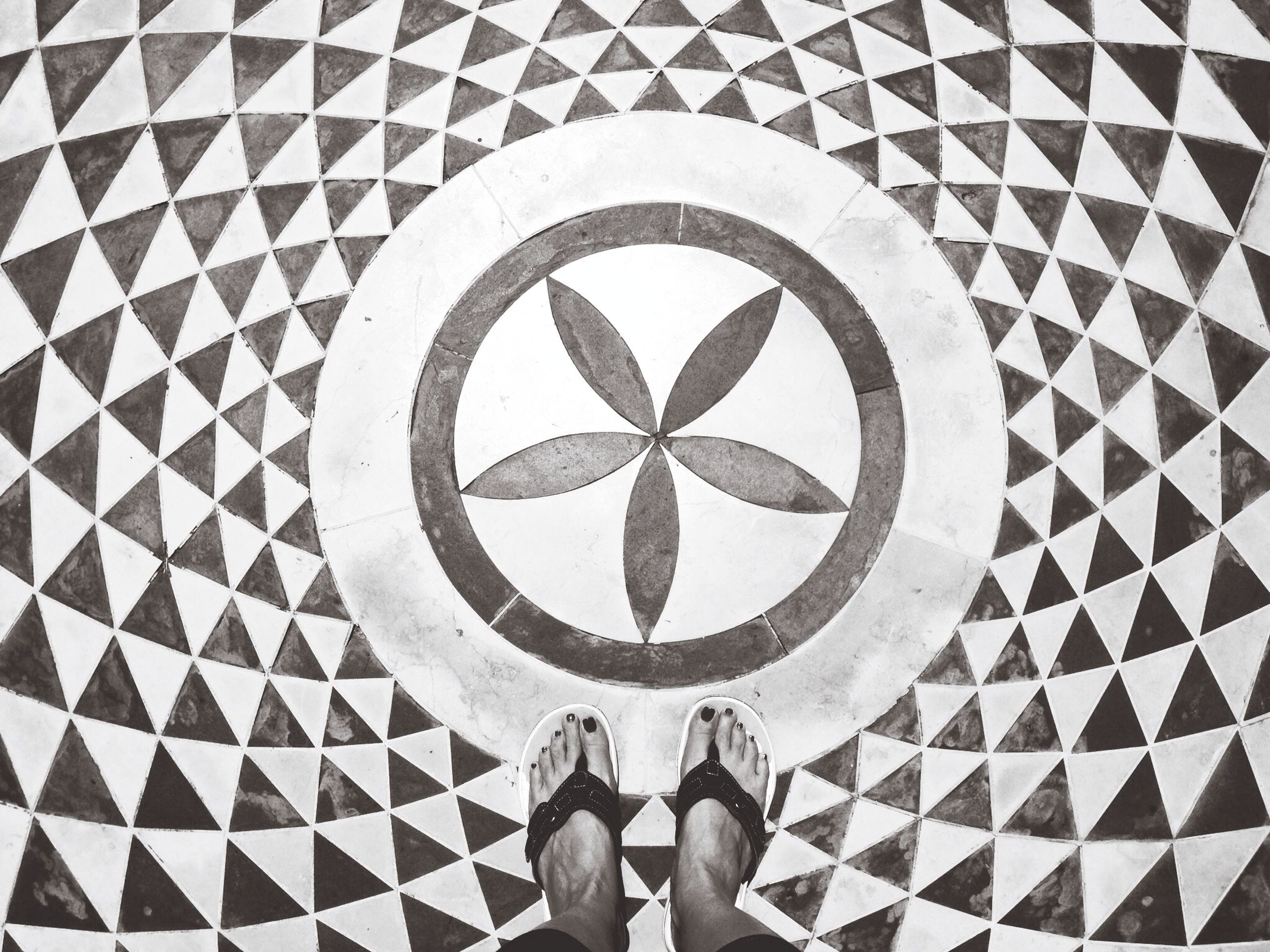 low section, lifestyles, standing, person, personal perspective, circle, leisure activity, men, geometric shape, unrecognizable person, shoe, pattern, high angle view, directly above, communication, day