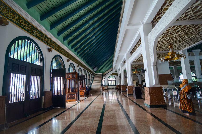 walkway Architecture Built Structure Indoors  Building Place Of Worship Religion Belief Flooring Incidental People Tiled Floor Ceiling