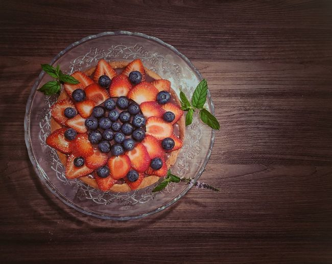 High angle view of orange fruits in bowl on table