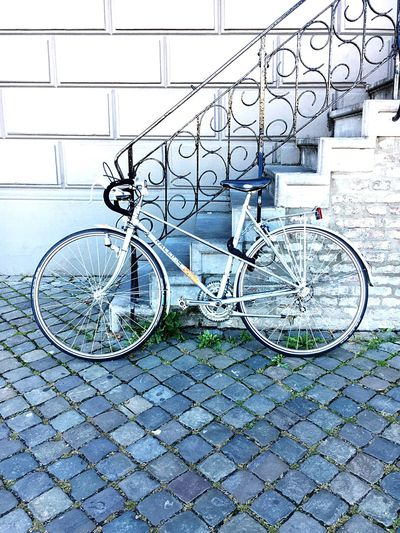 Bicycle on metal in city