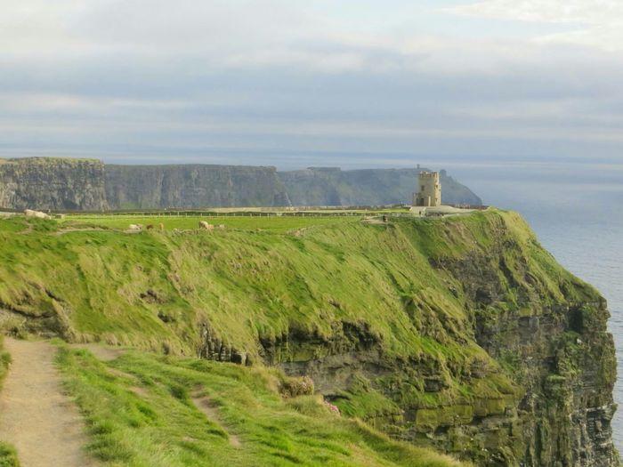 Ireland🍀 Cliffs Of Moher  Green Grass Dark Sky Irish Landscape Enjoying The View Grey Sky Castle Tower No Filter Cliffs
