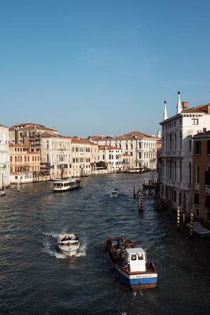 Architecture Blue Building Building Exterior Built Structure Canal City Clear Sky Copy Space Day Mode Of Transportation Nature Nautical Vessel No People Outdoors Passenger Craft Sky Transportation Travel Travel Destinations Venice Water Waterfront