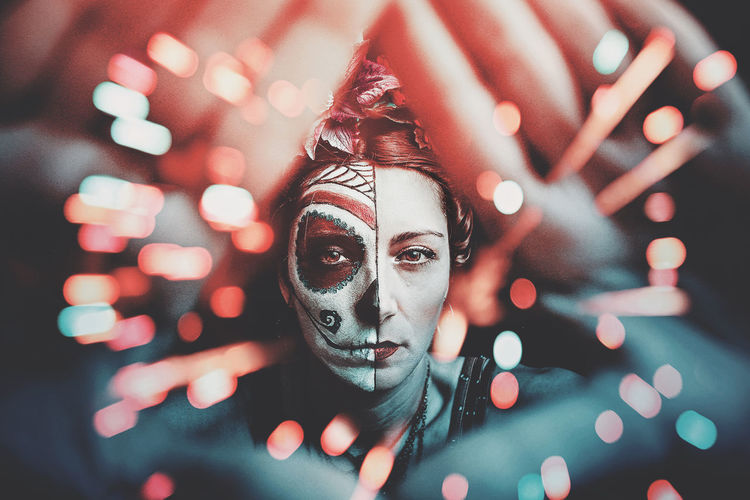 Halloween Makeup Adult Beautiful Woman Body Part Costume Front View Hand Headshot Human Body Part Human Face Illuminated Indoors  Leisure Activity Lens Flare Lifestyles Light - Natural Phenomenon Looking At Camera Night One Person Portrait Real People Selective Focus Skull Young Adult