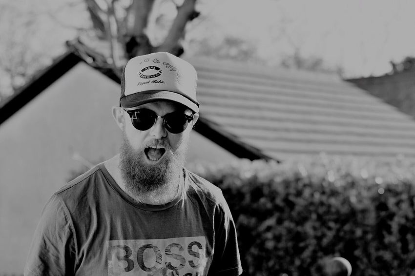 Just me giving a shoutout Sunglasses Real People Lifestyles One Person Outdoors EyeEmNewHere Rayban Black And White Kona Konabrewingco Nikon Nikonphotography NikonD500 The Portraitist - 2017 EyeEm Awards