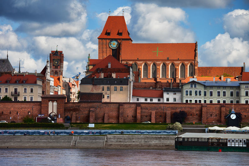 City of Torun in Poland, Old Town skyline with Cathedral of St. John the Baptist and St. John the Evangelist. Architecture Cathedral Church City Houses Old Town Poland Toruń Wall Building Building Exterior Europe Historic Historical Old Buildings Old City River Travel Destinations Urban Skyline
