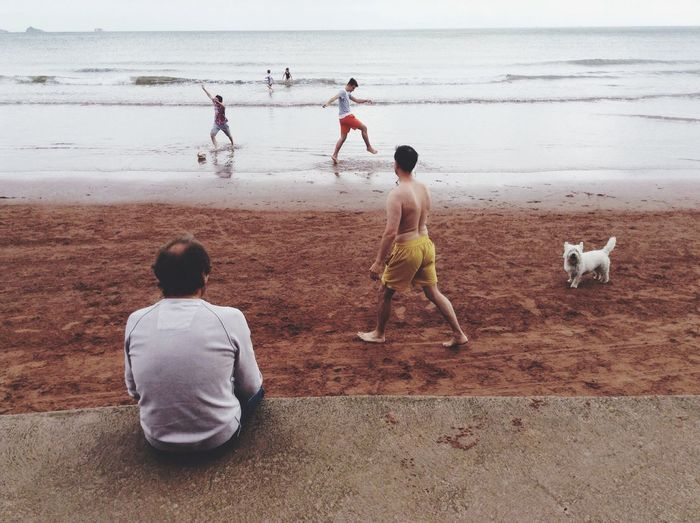 Mix Yourself A Good Time Beach Sand Sea Boys Playing Water Outdoors Leisure Activity Sky Summer The Week On EyeEm Rear View Real People Domestic Animals