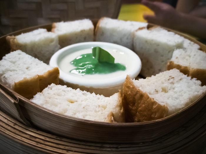 Steam thai sangkaya or pandan kaya bread with sweet dipping sauce.