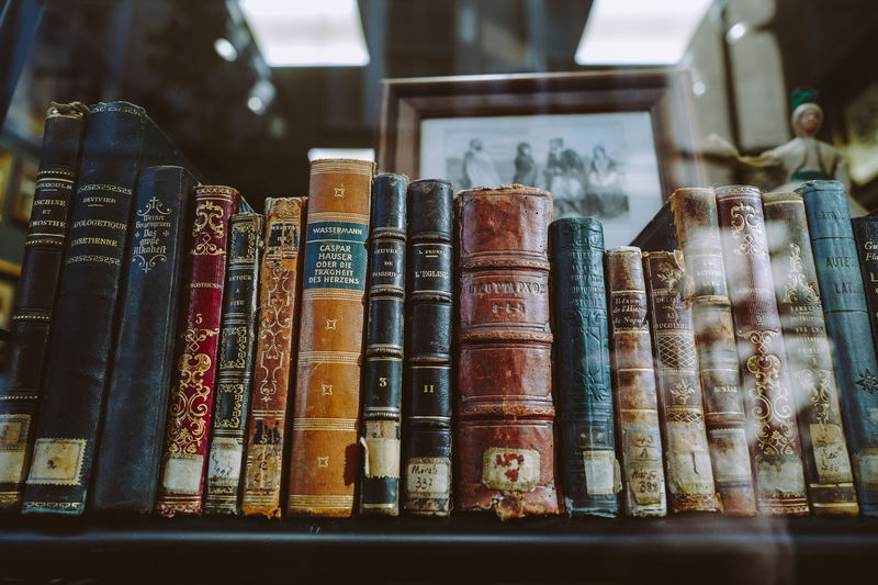 Vintage books with shabby covers on bookshelf