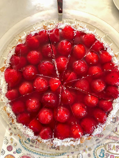 High angle view of strawberries on cake