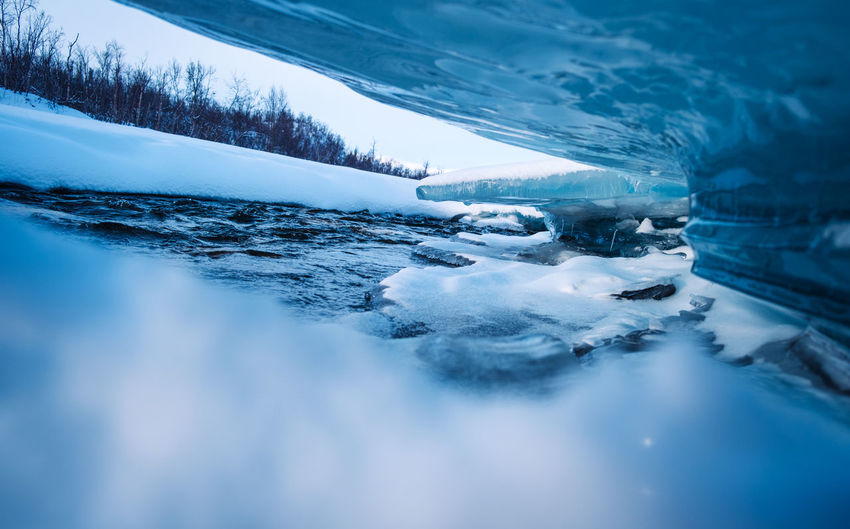 Ice formations created by the flow of the river in abisko nationalpark.