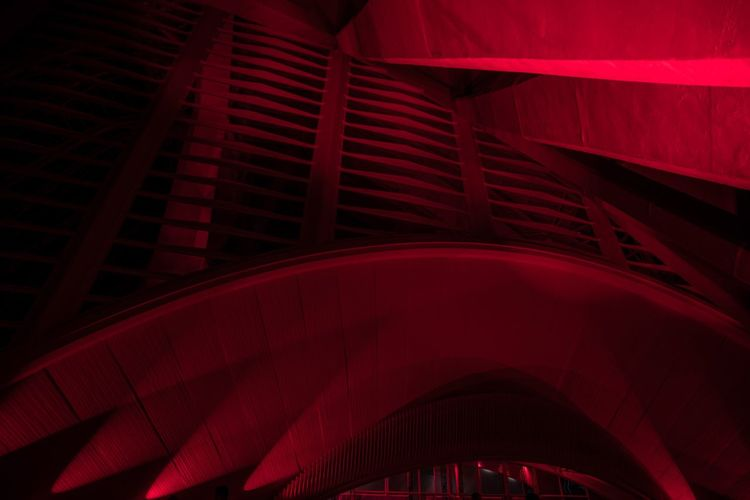 Low angle view of illuminated red building