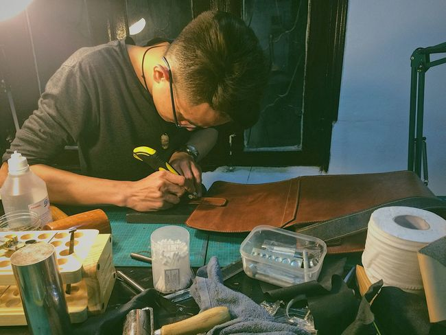 Leather man Real People Young Adult Handcraft Handmade Leather Craft Handyman Focus Object Hanoian