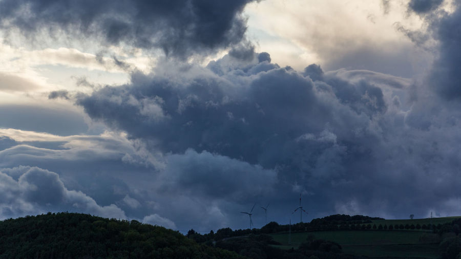 Low angle view of storm clouds over land