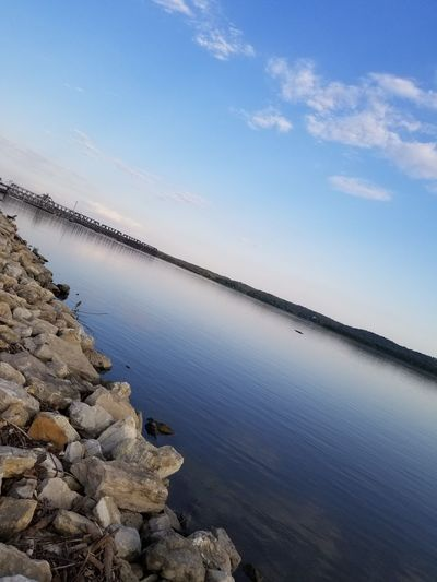 Waterfront Water River River View Riverside Riverbank Riverscape Iowa EyeEm Selects Salt - Mineral Water Sea Salt Basin Industry Blue Beach Sky Standing Water Calm Waterfront Rippled Mid Distance Rock Formation Capture Tomorrow