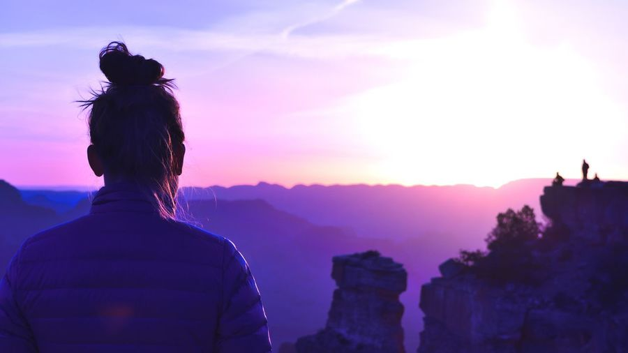 Rear View Of Woman At Grand Canyon National Park During Sunrise