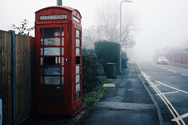Telephone Booth Built Structure Red Outdoors Tree Building Exterior Day City Pay Phone No People Architecture Cultures Nature Village Fog City Fog