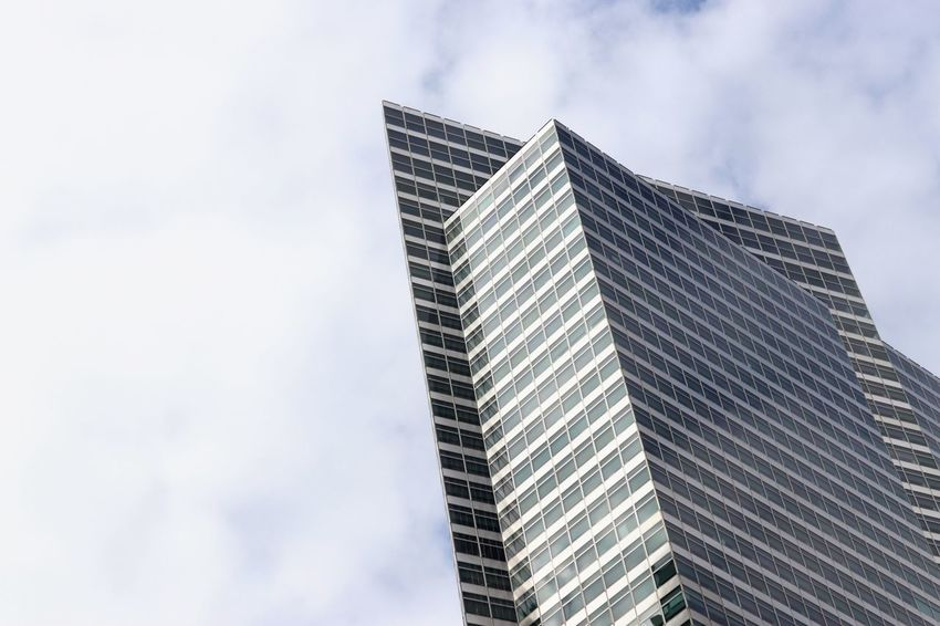 Manhattan New York EyeEm Selects Building Exterior Built Structure Architecture Building Low Angle View Office Building Exterior Sky City Office Cloud - Sky Modern Tall - High Skyscraper Day No People Nature Tower Outdoors Glass - Material Business