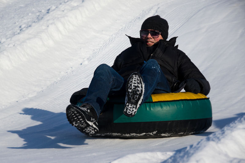 Snow slide with tube 4 Casual Clothing Fun Fun Hill Leisure Activity Men Real People Sitting Slide Slides Sliding Snow Snow Slide Snow Sliding Snow Tubbing Snow Tubing Tobogan Toboggan Toboggan In Winter Turkey Weekend Activities Winter Young Men