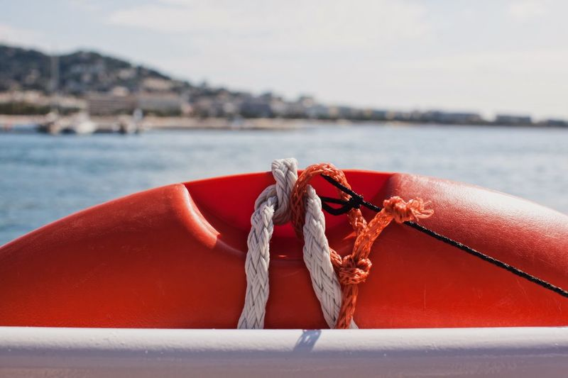 Close-up of rope tied to boat on sea