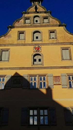 Architecture Façade Building Exterior Travel Destinations No People Built Structure History Low Angle View Outdoors Cityscape Sky City Clock Clock Face Blue Sky Yellow Wall Yellow Bavarian City Bavaria Tourism Architecture Bavarian Architecture Dinkelsbuhl