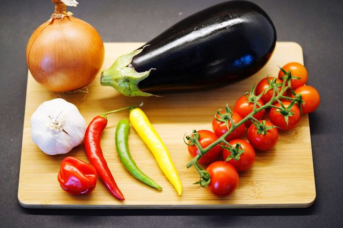 Vegetable Food Food And Drink Tomato Freshness Garlic Healthy Eating Table Still Life Cutting Board Indoors  Ingredient Raw Food No People Red Bell Pepper Variation Red Close-up Day