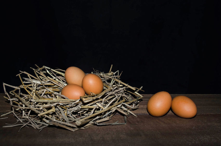 Chicken eggs and the straw on the dark wooden floor Animal Egg Black Background Close-up Day Egg Egg Yolk Food Food And Drink Fragility Freshness Healthy Eating Indoors  Large Group Of Objects No People Raw Food Studio Shot Wood - Material