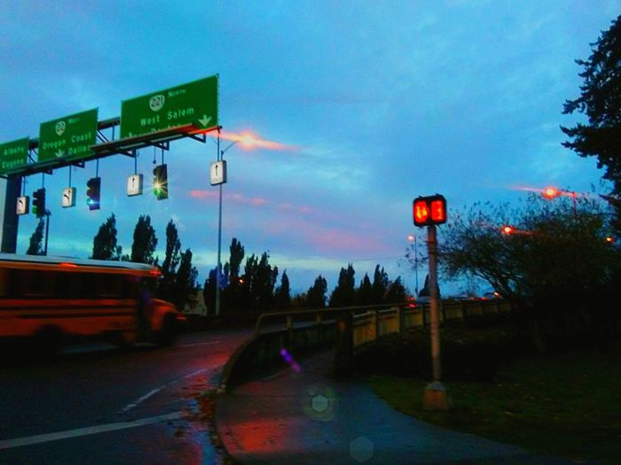 Merging Bridge - Man Made Structure On The Way The Drive Illuminated Transportation Cloud - Sky Dramatic Sky Outdoors Road Sign Nature Mode Of Transport Built Structure The Way Forward Telling Stories Differtenly Sunrise_Collection Oregon Sunrise The Week On EyeEem EyeEm Master Class City Life Pursuit Of Happiness Focus On Foreground Streamzoofamily Landscape Schoollife