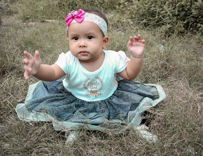 Young Baby Child One Person Innocence Cute Front View Childhood Clothing Babyhood Portrait Real People Baby Clothing Lifestyles Full Length Nature Looking At Camera Toddler  Outdoors