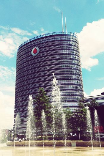 Modern Architecture Vodafone  Headquarters Fountain Sunshine At The Office Built Structure Modern City Design Building Architectural Feature Tower Honor 7 Smartphonephotography Honor7