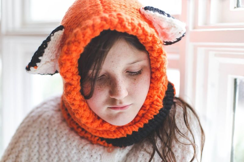 Close-Up Of Cute Girl Wearing Knitted Headwear