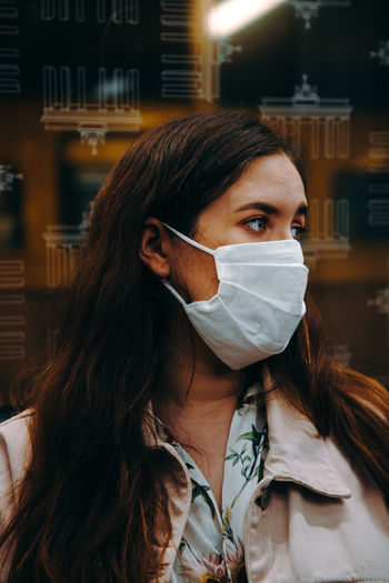 Portrait of woman wearing a face mask in an underground train