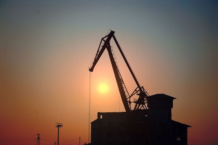 Miles Away Sunset No People Development Outdoors Sky Construction Machinery Construction Nature Industrial Equipment Day City Street Travel Sunset Light Sunlight Shadow Silouette & Sky Sillouette Tranquil Scene Tranquility Rural Scene Nature Landscape Photography