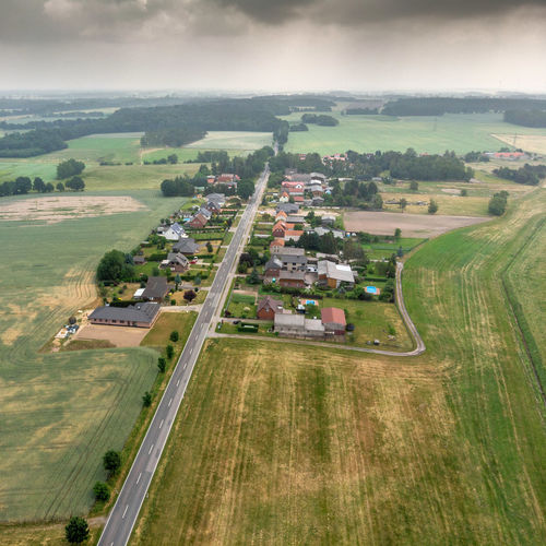 Aerial view of a village suburb in the rural area of Saxony-Anhalt Aerial Aerial View Agriculture Architecture Cloud - Sky Countryside Day Drop Environment Field Growth High Angle View Land Landscape Mode Of Transportation Nature No People Outdoors Plant Scenics - Nature Sky Transportation Tree