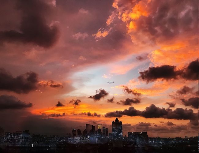 Sky Architecture Sunset Cloud - Sky City Orange Color Building Exterior Travel Destinations Landscape Dramatic Sky No People Scenics - Nature Nature Beauty In Nature Cityscape Outdoors Building Illuminated Urban Skyline Built Structure