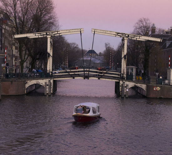 Amsterdam in all its beauty! Amsterdam Amsterdam Canal Nederland Netherlands Nightphotography Twilight Amsterdamcity Ancient Bridge Ancient Structure Bridge Canals Canals And Waterways Dusk Waterreflections