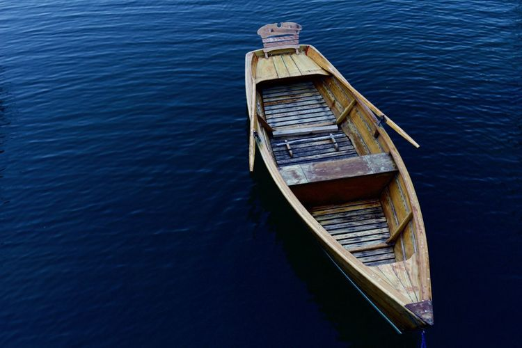 High Angle View Of Boat Moored On Lake