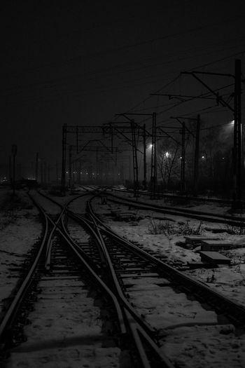 Tracks in the night. [[]] I went for a bus but I missed it so I've done this on my way back. City Nature Night Night Photography Nightphotography No People Outdoors Rail Transportation Railroad Railroad Station Railroad Track Sky Tracks Transportation Winter