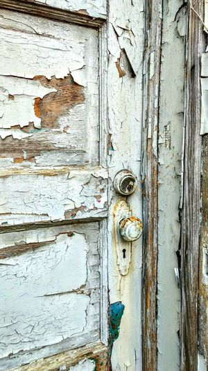 Full Frame Backgrounds Weathered Architecture Built Structure Old Close-up Deterioration Damaged Building Exterior Day Peeling Off No People Peeling Doorway Peeling Paint Weathered Wood Architecture Patterns & Textures Cracked Paint Door Knob White Color Old Door Door Jamb Graham, NC