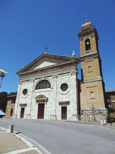 Italy🇮🇹 Religion Place Of Worship Spirituality Architecture Built Structure Building Exterior Outdoors Blue Clear Sky Day Low Angle View No People Clock Tower Bell Tower Sky Church Tower City's Of The World Way To Live