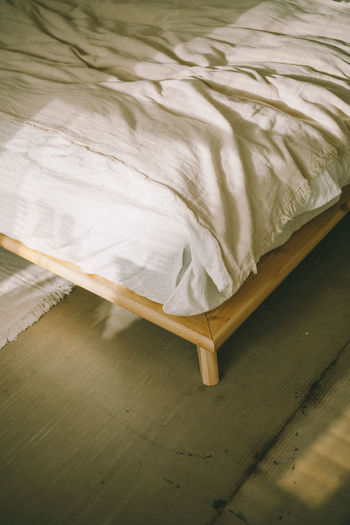High angle view of paper on bed