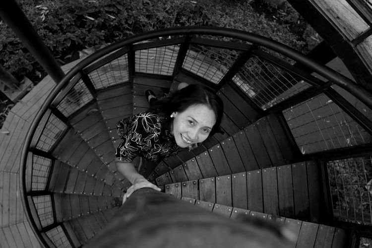 High angle view of woman on staircase