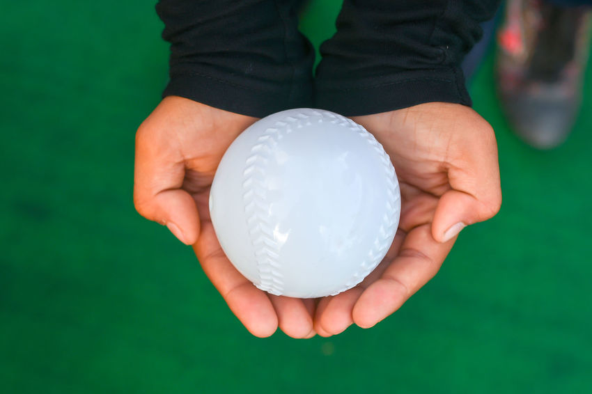 A boy holding baseball rubber ball Baseball Children Ball Close-up Crystal Ball Finger Focus On Foreground Front View Green Color Hand Hands Cupped Holding Human Body Part Human Finger Human Hand Human Limb Indoors  Lifestyles Offspring One Person Real People Rubber Ball Sphere Teeball Unrecognizable Person