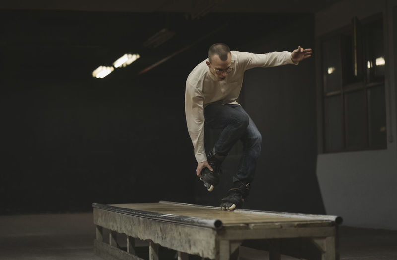 Man inline skating on table